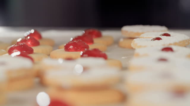 Baker preparing butter cookies with strawberry jam Baker preparing butter cookies with strawberry jam jello stock videos & royalty-free footage