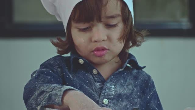 vídeos de stock e filmes b-roll de bakery and boy - baking bread at home