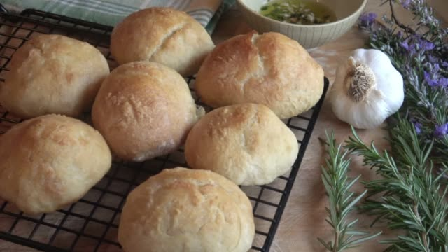 Baking Artisan Bread Rolls A Tray of Freshly Baked Bread Roll Fresh out of the Oven. bun bread stock videos & royalty-free footage