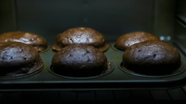 Baking Chocolate Muffins: Concept Baking Muffins: Concept baked stock videos & royalty-free footage