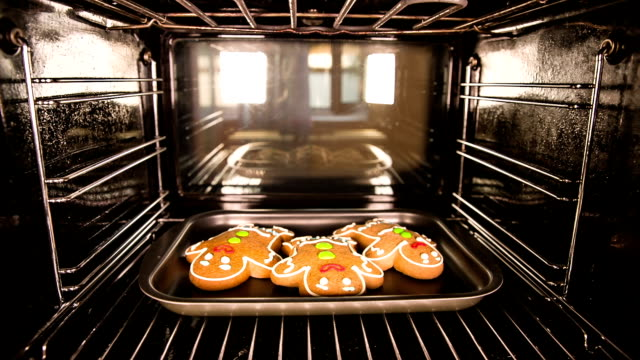 Baking Gingerbread man in the oven. Cooking in the oven. video
