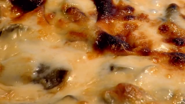 baking lasagna close up baking lasagna with vegetables, cheese and bechamel, boiling hot in an oven. Traditional italian dish. Close up zooming out. Traditional italian dish. macaroni stock videos & royalty-free footage