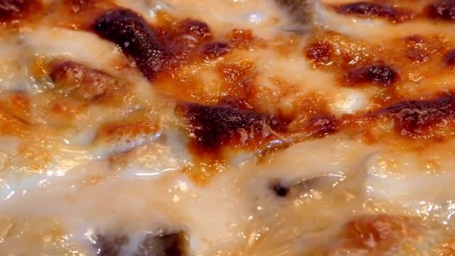 baking Moussaka close up baking Moussaka with vegetables macaroni stock videos & royalty-free footage