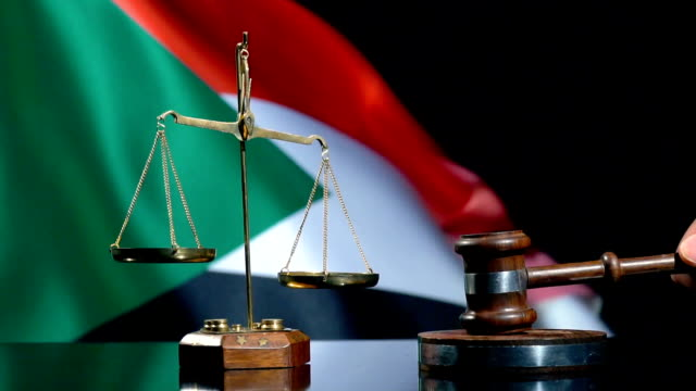 balance and gavel with sudanese flag - sudan del sud video stock e b–roll