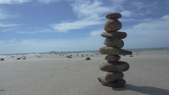 balance stone on the beach video