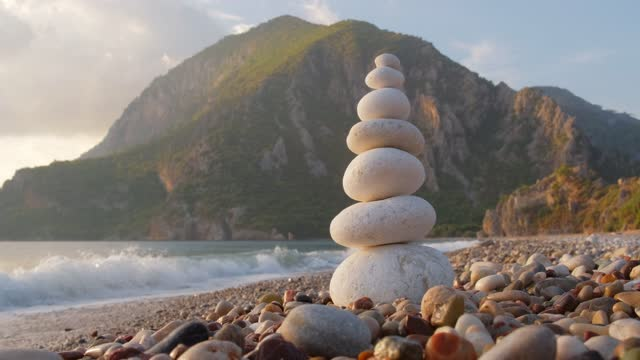Balance stones on the Cirali beach at sunset, Turkey Balance stones on the Cirali beach at sunset, Antalya province, Turkey heap stock videos & royalty-free footage