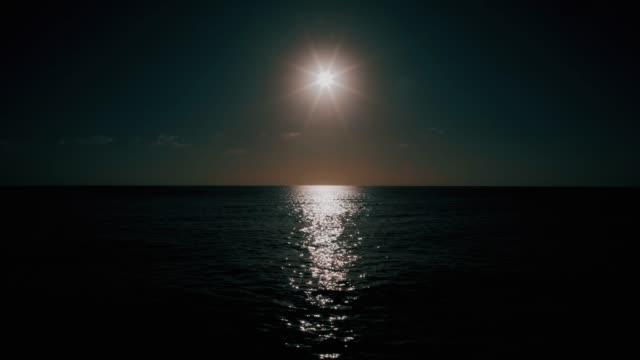 balearic sea in the morning reflecting sun - спокойная вода стоковые видео и кадры b-roll