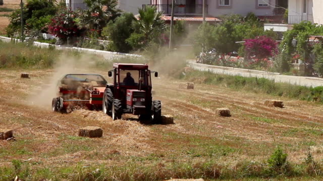 Baler making straw bales video