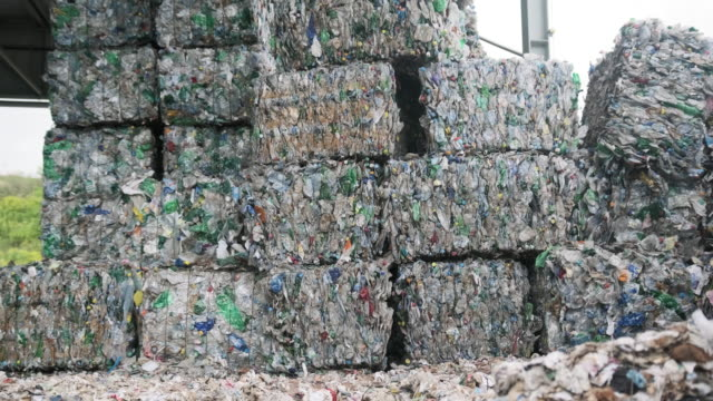 Bales of Compressed Recyclable Materials Stacked Outdoors video