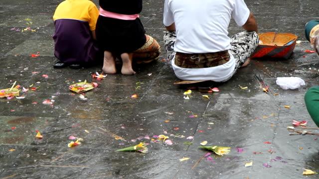 MS Balinese Family Praying In Temple