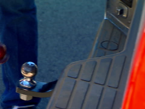 ball hitch Attaching a trailer to a truck's tow hitch. towing stock videos & royalty-free footage