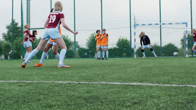 Ball hitting the post in female soccer match Soccer player getting pass to her teammate who trying to shoot goal but ball hitting the post goal post stock videos & royalty-free footage