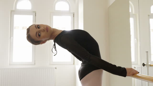 Ballerina bending over backwards. video