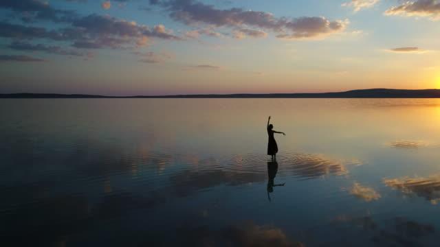 Ballerina dancing on the lake Ballet dancer dancing on the lake - Salt lake in Turkey ballet dancer stock videos & royalty-free footage