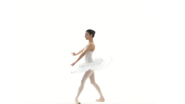 Ballerina dancing with white tutu on white background in slow motion - video