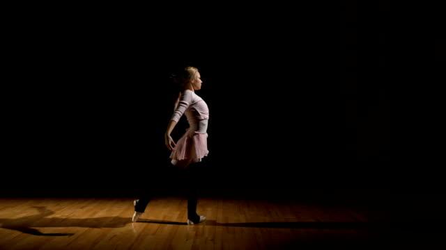 Ballerina exercising dance elements before performance