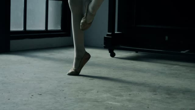 Ballerina girl trying to balance on toes in studio - Stock video video