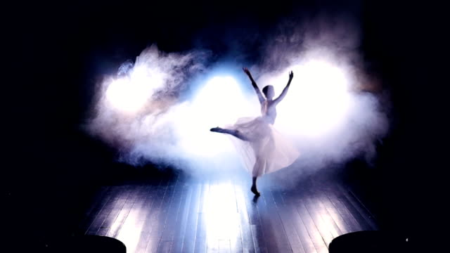 Ballerina jumping on the stage. No face. Slow motion. HD. video