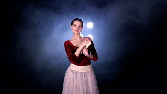 Ballerina portrait. A ballerina keeping her shoes closely. video