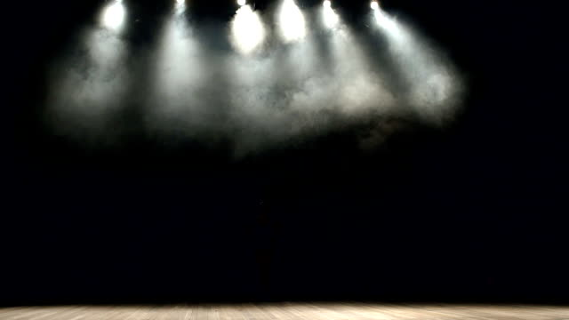 Ballerina spinning on stage in dark, slow motion. video