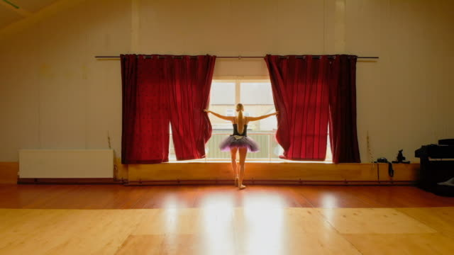 Ballerina stretching in the dance studio 4k Rear view of ballerina stretching in the dance studio 4k leotard stock videos & royalty-free footage