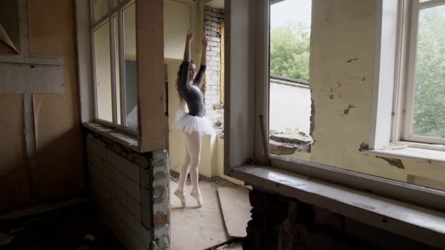 A ballerina trains in an abandoned building video
