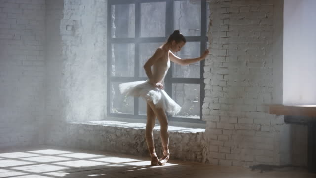 Ballerina warming up before training in studio video