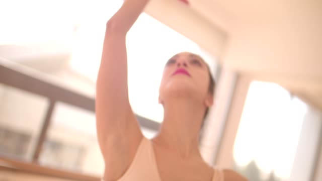 ballet dancer gracefully dancing with her arms in the air - tutù video stock e b–roll