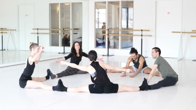 Ballet dancers doing stretching exercise in circle video
