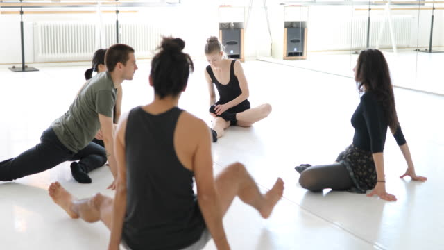 Ballet dancers doing stretching exercise in class video