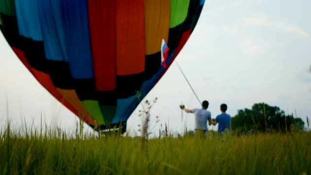 A balloon crew inflates the envelope of their hot air balloon video