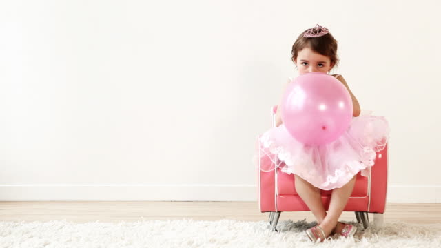 Balloon Princess Little princess playing with a pink balloon. princess stock videos & royalty-free footage