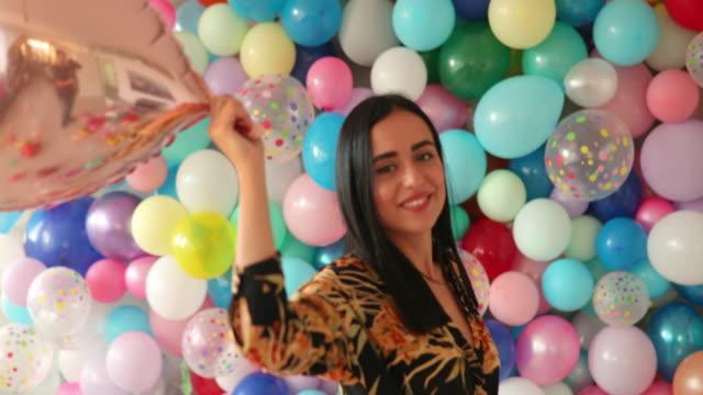 Balloons always make her smile