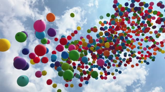 Balloons flying into the sky Thousands of colorful balloons are released. They are flying into the sky. happy birthday stock videos & royalty-free footage