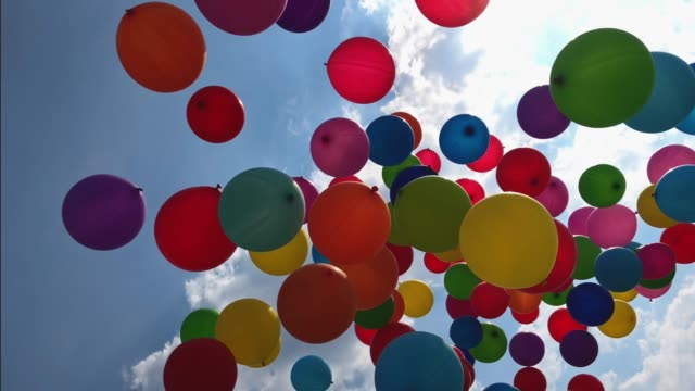 Balloons flying into the sky video