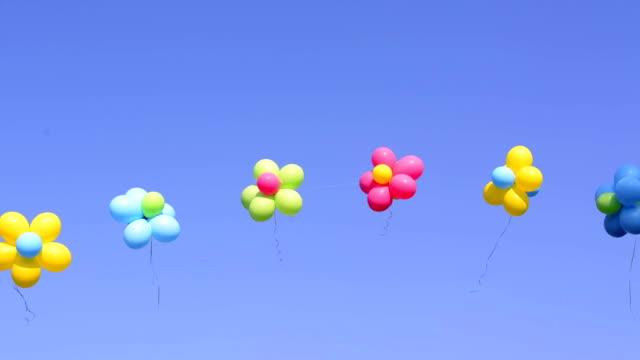 balloons - blue yellow band bildbanksvideor och videomaterial från bakom kulisserna