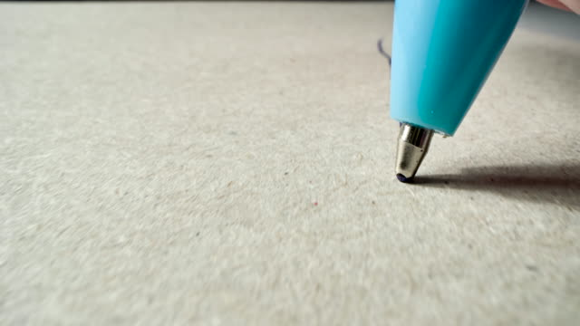 Ballpoint pen writes or draws on paper