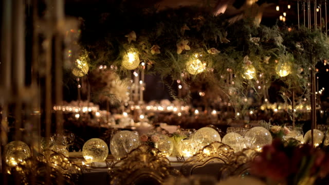 ballroom event decoration with beautiful chandeliers and lights Decoration with some flower arrangements and candles.. 19th century style stock videos & royalty-free footage