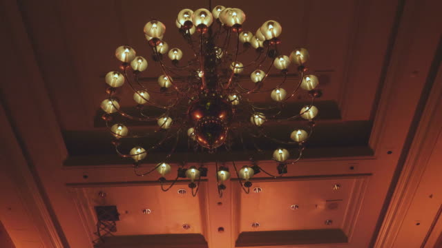 ballroom  large chandelier - soffitto video stock e b–roll