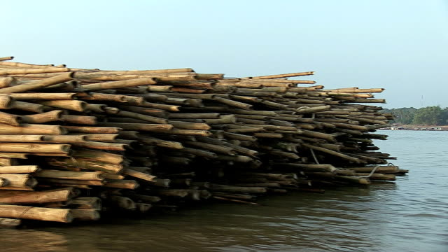 Bamboo poles tied together and pulled behind a boat video