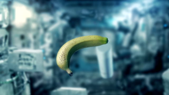 stockvideo's en b-roll-footage met banaan en objecten zweven binnen space shuttle - tropisch fruit