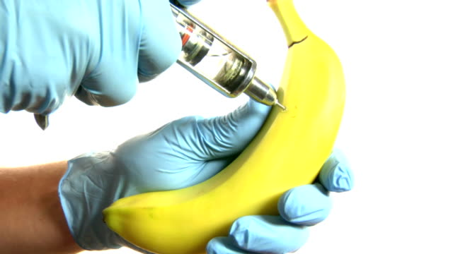 Banana Injected by gloved hand video
