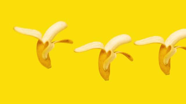 bananas jumping and dancing animation at yellow background.
