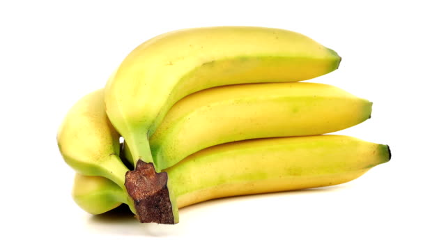 Bananas Rotating Bunch of ripe bananas turning slowly on plain white background bunch stock videos & royalty-free footage