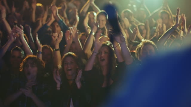 Band entering stage A rock band entering stage on a concert wile the audience is waiting for them.   performer stock videos & royalty-free footage