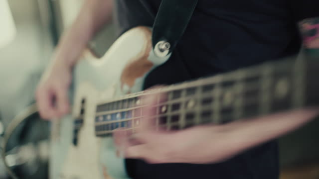 Band playing in their rehearsal studio: bass guitar player video