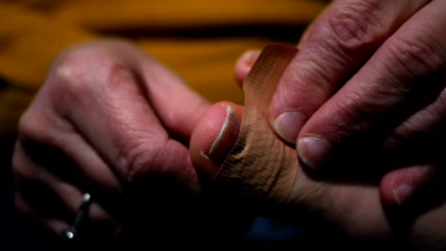 A bandage is put on an infected toe video