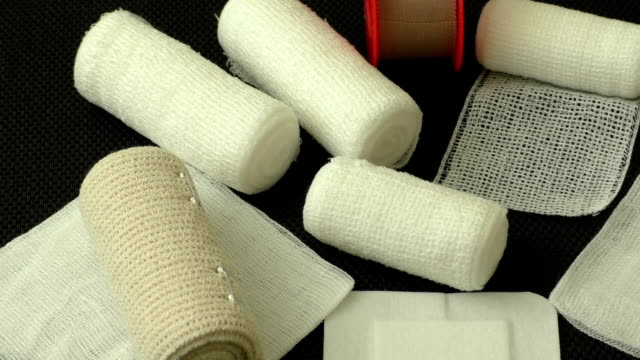 Bandages and plasters on a black background video