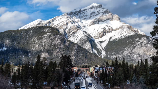 Banff town and distant mountain time lapse daytime video