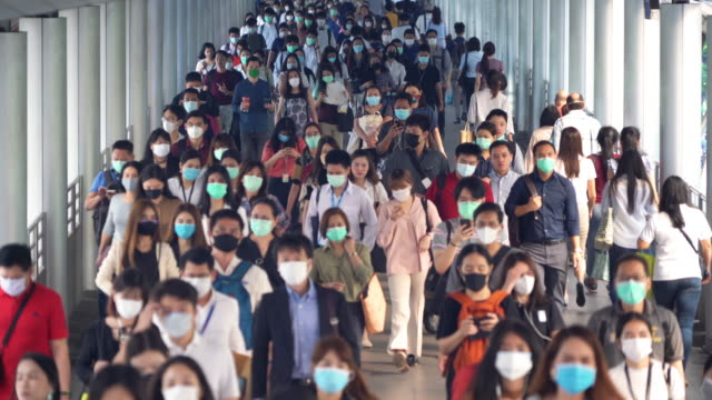 Bangkok City, Thailand : 03/12/2020 : Unidentified people, Crowd of Thai wearing face mask for health due to Coronavirus Disease or covid-19 and air pollution in mass transit in public. Rush hour. Bangkok City, Thailand : 03/12/2020 : Unidentified people, Crowd of Thai wearing face mask for health due to Coronavirus Disease or covid-19 and air pollution in mass transit in public. Rush hour. bangkok stock videos & royalty-free footage